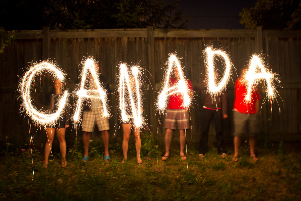 Group of children celebrating Canada with fireworks