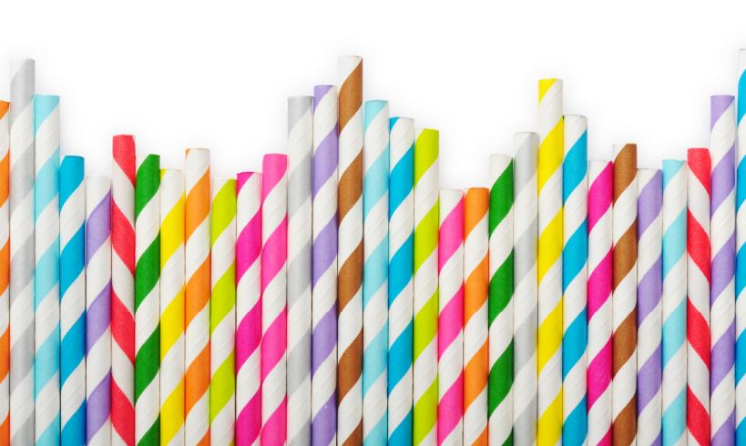 Colourful biodegradable straws in a row