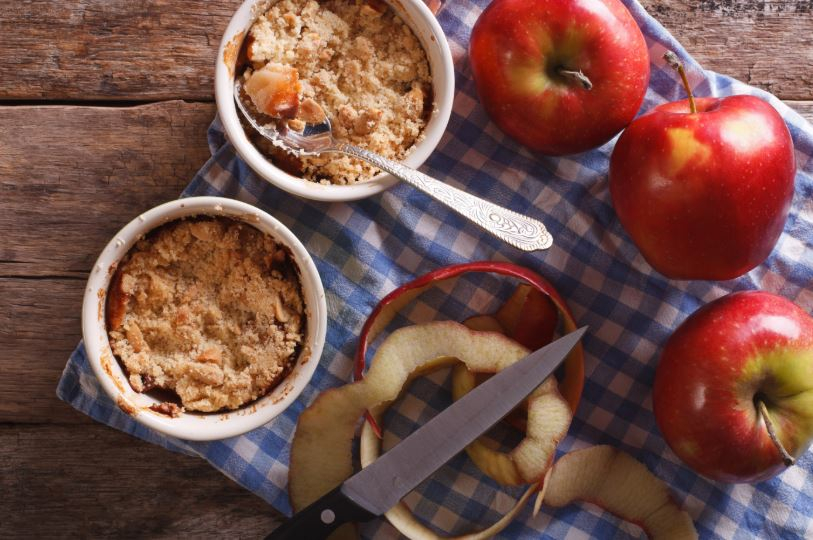 Ontario apples next to apple crumble dessert ramekins