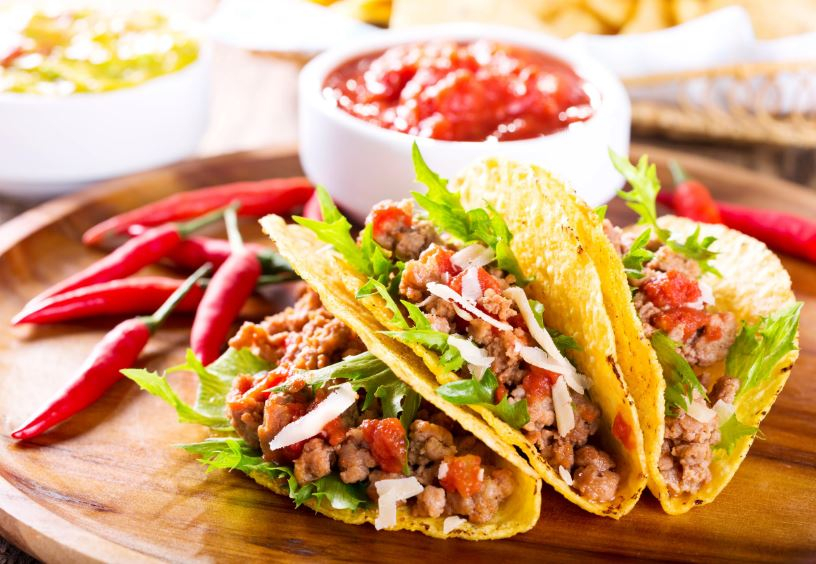 Beef tacos on a plate with salsa