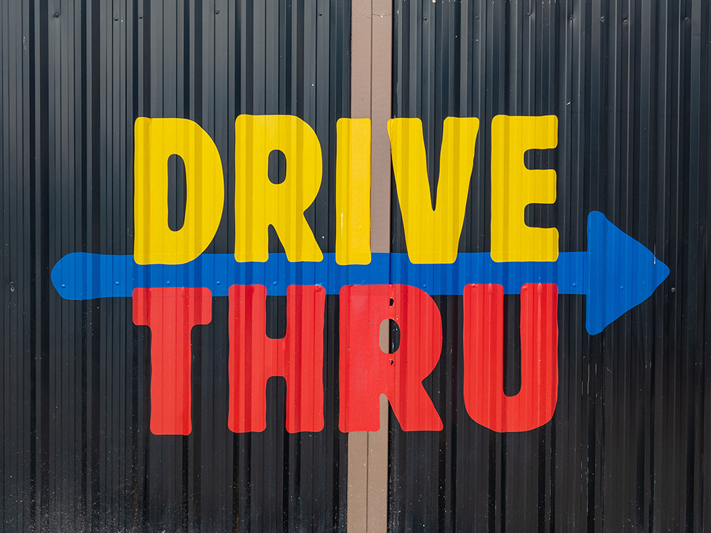 Sign promoting Drive Thru on a black background