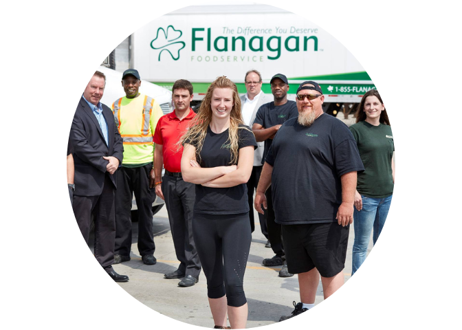 Group of Flanagan drivers smiling with truck in background