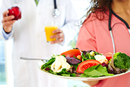 A nurse serving a healthy salad