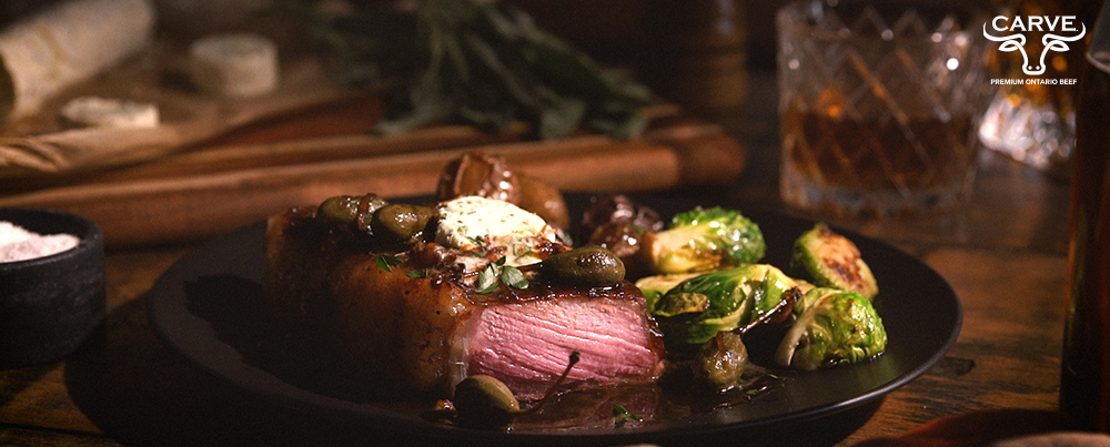 Carve Beef Seared Striploin with Whiskey-Sage Compound Butter and Caper Berries Recipe Photo