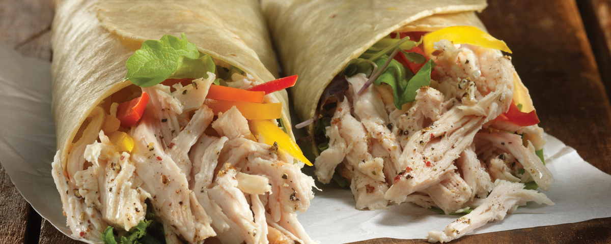 Schneiders pulled chicken piri piri wraps on a wood background