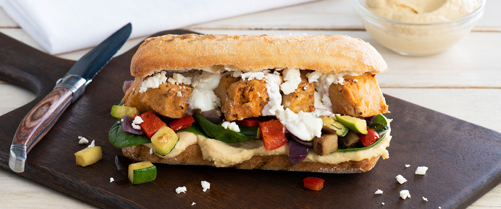 Pork Souvlaki Sandwich with Roasted Veggies and Hummus Recipe