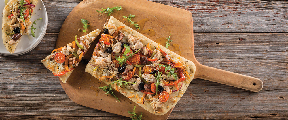 Maple Leaf Pulled Chicken Pizza on flatbread with olives and tomatoes
