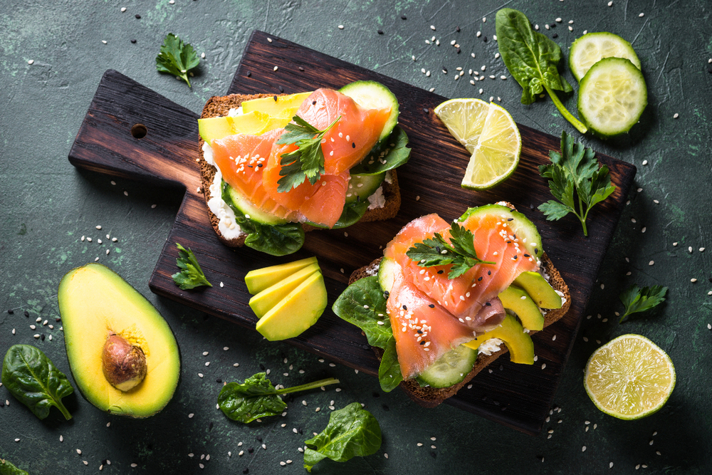 Fresh salmon with cucumber and avocado on bread