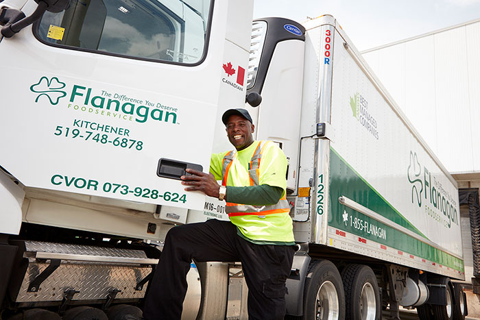 Employee with a Flanagan's truck